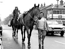 Red Rum with Billy Ellison walking back to Ginger McCain's yard in Southport