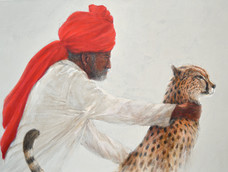 Man Holding Cheetah in Check